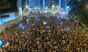 Hong Kong protests escalate as hundreds of thousands rally for democracy