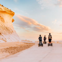 Family on segway's in Xwejni, Gozo